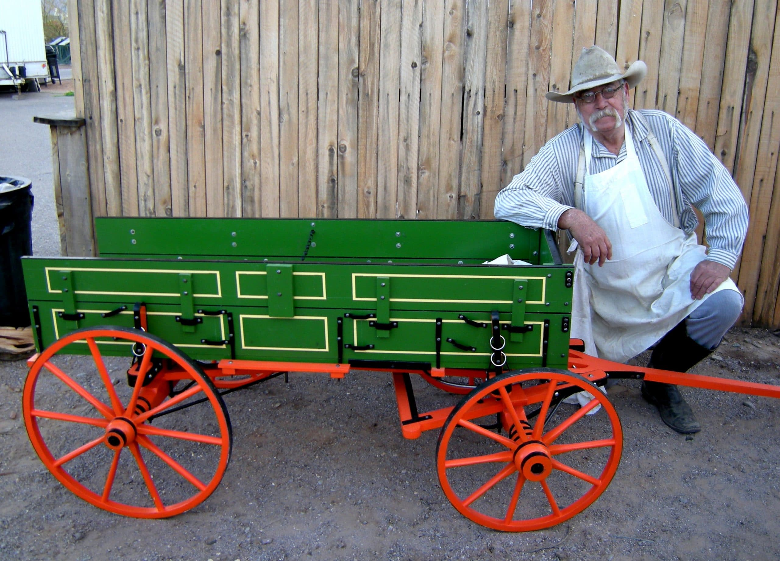 Man with old-fashioned wagon